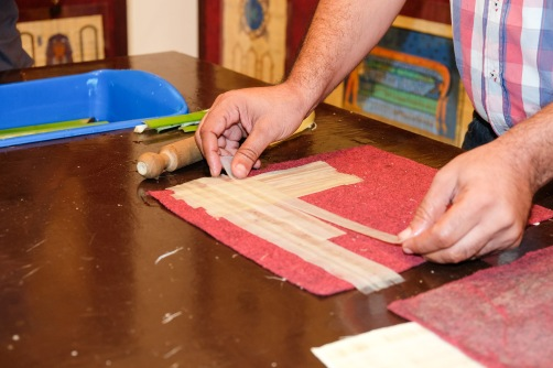 A demonstration of how the Egyptians make papyrus paper, an ancient staple good.