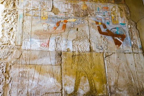 An example of defaced portrait and cartouches of Hatshepsut in the Temple of Karnak.