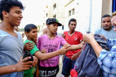 Elizabeth Baker handing out soccer balls from her nephew, Kassem Akil.
