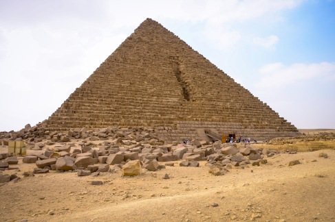 The side of this pyramid was bombed to retrieve the treasures inside. They were lost at sea when the ship transferring the treasures sunk.