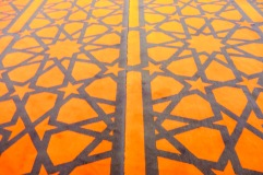 The lines which the men align themselves to pray on in the Mosque.