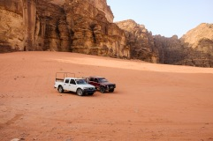 The trucks we toured the Wadi Rum desert in.